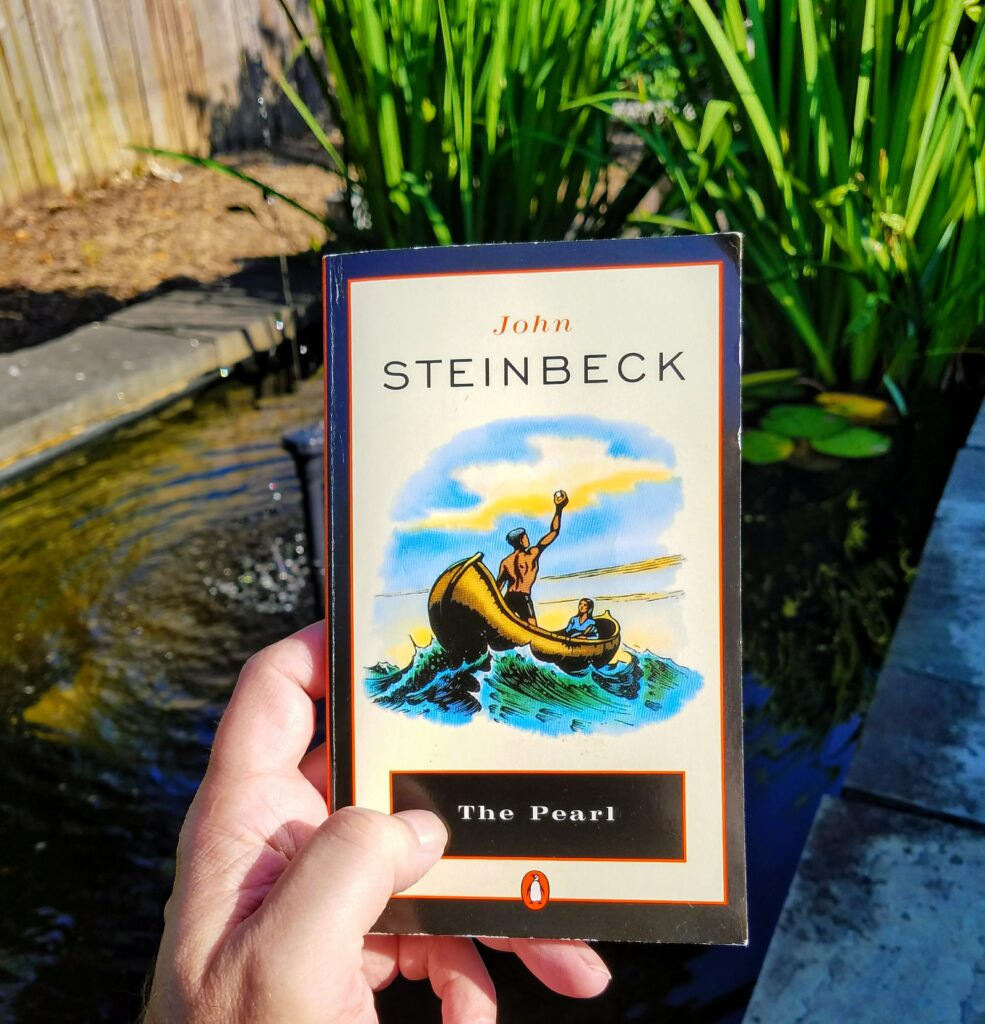 Tamara, when you read this, you'll know where I took it. Something I do—take a picture with The Pearl where I am—when I travel and have a morning's moment to re-read Steinbeck's story and reflect.